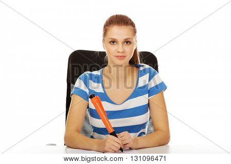 Pretty teenager woman writing something with huge pen