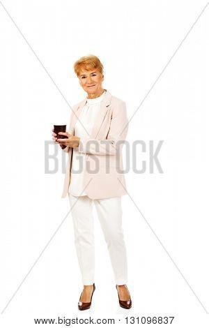 Smile elderly elegant woman holding paper cup