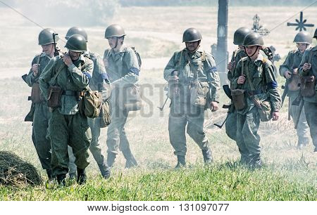 NITRA SLOVAK REPUBLIC - MAY 21: Reconstruction of the Second World War operations between Red and German army group of tired german soldiers returns from the front line on May 21 2016 in Nitra Slovak Republic.
