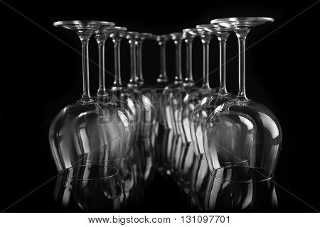 Empty wine glasses on black background, closeup