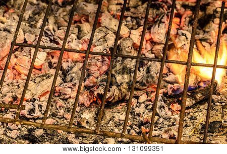 Close up grill and embers for doing barbecue.