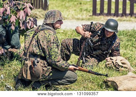 NITRA SLOVAK REPUBLIC - MAY 21: Reconstruction of the Second World War operations between Red and German army german soldiers in defensive position on May 21 2016 in Nitra Slovak Republic.