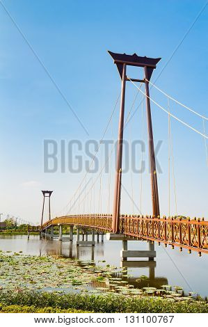 Beautiful bridge across the lake against blue sky background