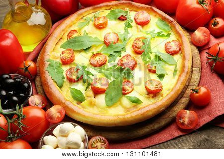 Pizza Margherita with arugula and vegetables, close-up