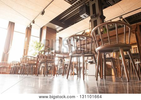 Low angle of wonderful modern restaurant with wooden chairs and tables