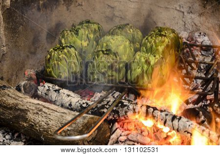 Artichokes Being Grilled In The Barbecue, Catalan Food.