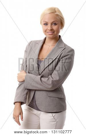 Portrait of happy young blonde businesswoman smiling, looking at camera.