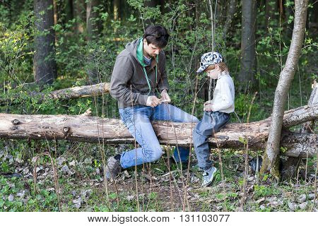 Dad And Little Son Having Picnic