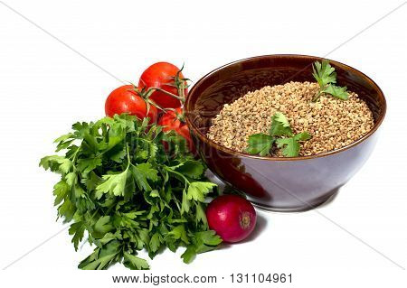 plate with buckwheat parsley a garden radish tomatoes isolate a subject products