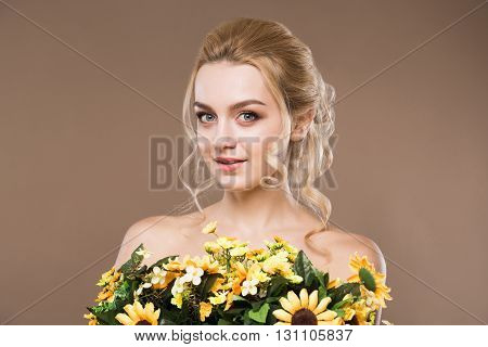 Portrait Of A Girl With Flowers In Hand