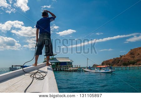LABUANBAJO, INDONESIA - August 24 2009: unidentified sailorman arriving in Kanawa island. Kanawa is a starting point for turists to explore Komodo and Rincha