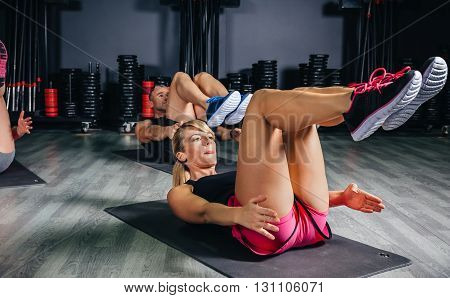 People doing abs in fitness class on sports center