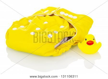 Modern cloth diapers and rubber duck isolated on white background.
