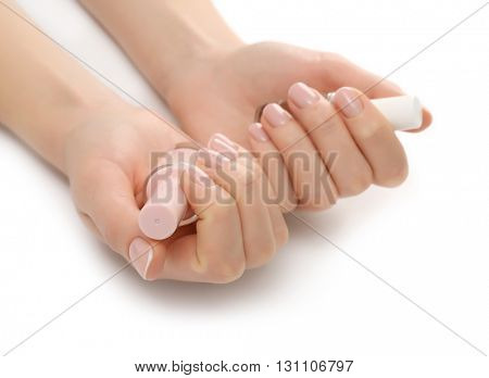 Woman hands with nail polish isolated on white background