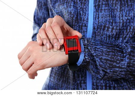 Red sport watch on female wrist, isolated on white