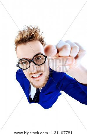 Angry businessman showing his finger at the camera. Isolated over white.