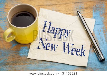 Happy New Week  - cheerful handwriting on a napkin with a cup of coffee