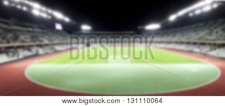 de focused background of soccer or football stadium at twilight