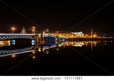 Palace bridge in Saint Petersburg, Russia at night. Illumination and lights, dark sky