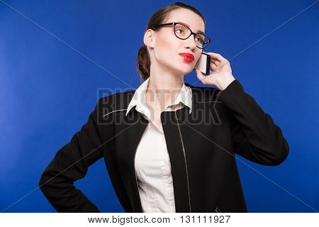 Young Woman With Glasses Talking On The Phone