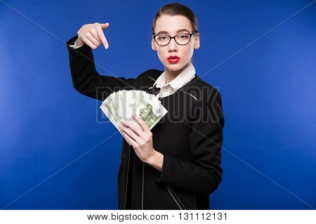 Young Girl With A Stack Of Money In The Hands Of