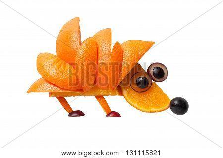 Hedgehog made of orange and grape on white background
