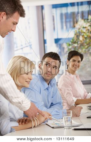 Young businesspeople having business meeting in office boss explaining giving instructions.?