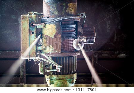 old motor to hook in an abandoned warehouse
