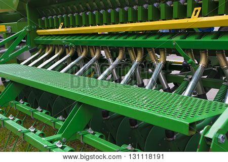 Green and zellow Agricultural machinery for a Farming Tractor