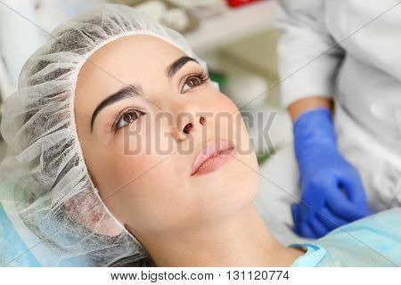 Young woman in plastic surgery centre