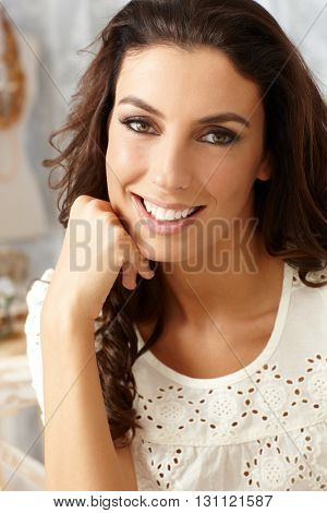 Closeup portrait of beautiful young smiling woman looking at camera.