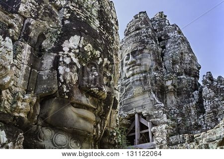 Bayon stone faces in Bayon temple at Angkor Siem Reap Cambodia.