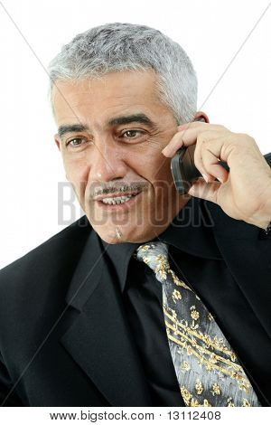 Happy mature businessman talking on mobile phone, smiling, isolated on white background.?