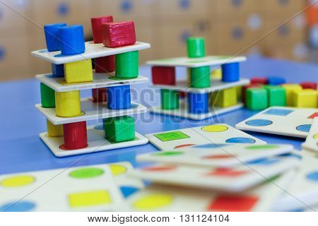 Do-it-yourself educational wooden colorful game made for stacking arranging and building. Learning through experience concept creative playing and educational approach concept.