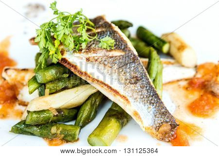 delicious plate of fish and carrot and vegetables