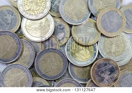 background of euro coins including one euro and two euros