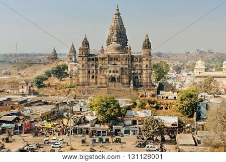 MADHYA PRADESH, INDIA - DEC 23, 2015: Historical landscape of India with Chaturbhuj Temple and narrow streets around on December 23, 2015 in Orchha. Madhya Pradesh is the 2nd largest indian state by area.