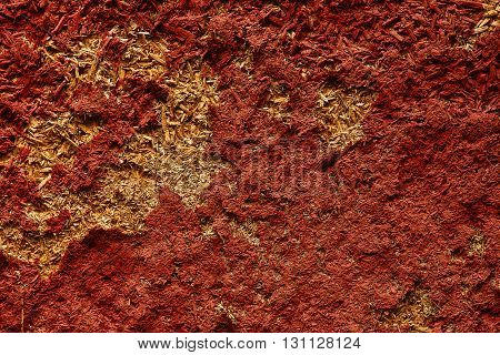 a red  background of old peeling wall