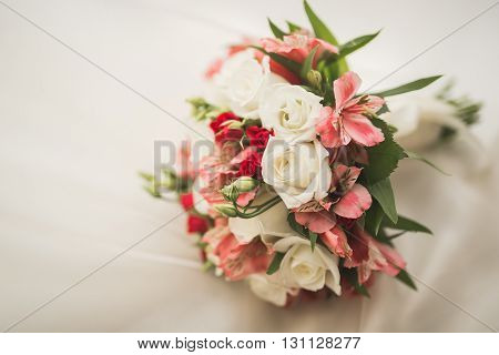 Wedding perfect bridal bouquet of different flowers.