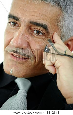 Mature gray haired creative looking businessman thinking, isolated on white background.?
