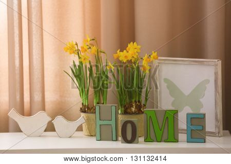 Beautiful narcissus and home decor on curtain background