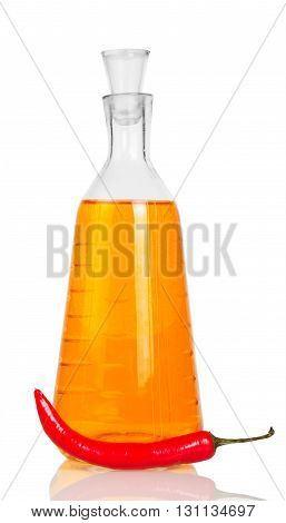Bottle of vodka and red chili peppers isolated on white background.