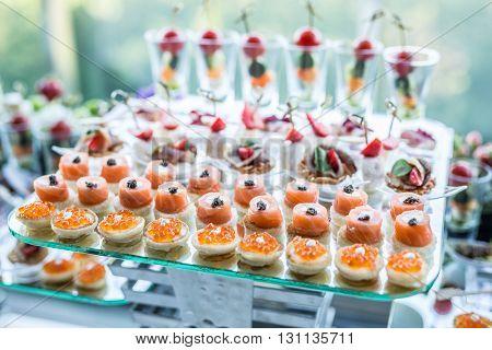 Assortment of canapes. Banquet service.