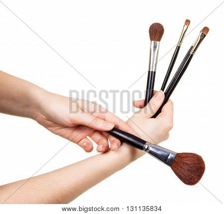 Cosmetic Makeup Brush in female hands isolated on white background.