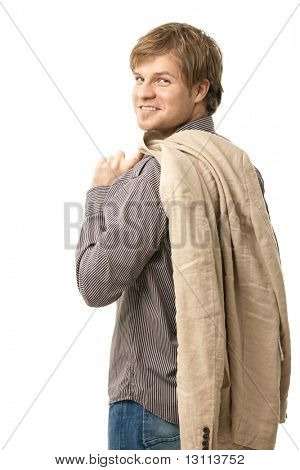 Portrait of trendy young man, standing with jacket over shoulder. Isolated on white.