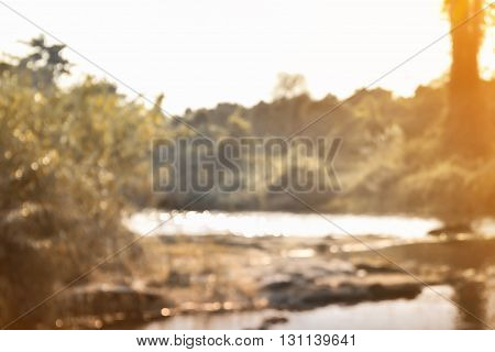 Blurred Background De-focused Nature View Of Water Surface Shining Bokeh, Landscape River, Tree In O