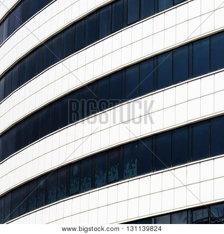 Close-up of modern industrial building made of glass and steel. Modern industrial architecture.