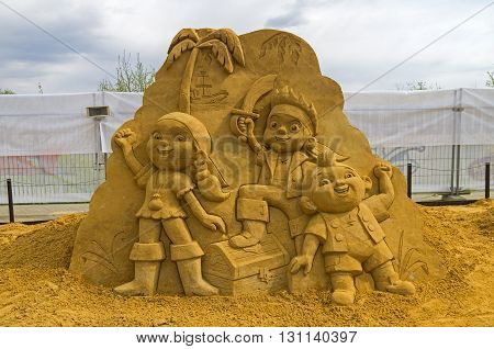 MOSCOW RUSSIA - May 1 2016: The exhibition of sand sculptures in Kolomenskoye Park. Composition on cartoon