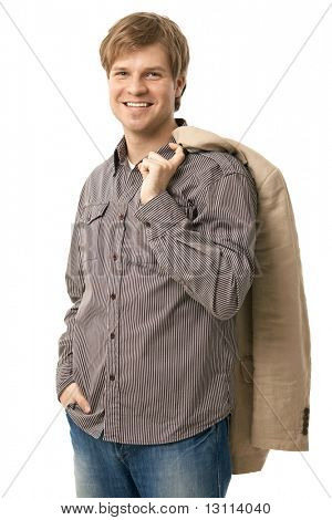 Portrait of casual young man, standing with jacket over shoulder. Isolated on white.?