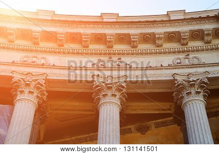 Sculptural details of the Kazan Cathedral colonnade in Saint-Petersburg Russia with birds sitting on the building